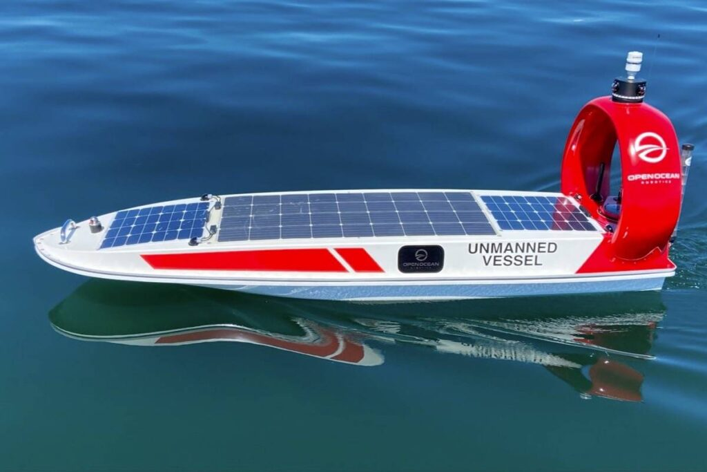 Data Xplorer a solar-powered autonomous boat on the water. It has a round spherical shape on its back and solar panels on its surface.